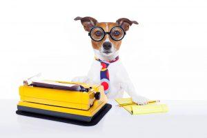 Dog typing on a typewriter